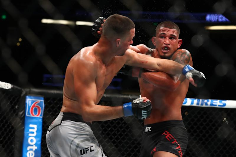 Anthony Pettis throws a punch in the second round against Nate Diaz during their Welterweight Bout at UFC 241 at Honda Center on August 17, 2019 in Anaheim, California.