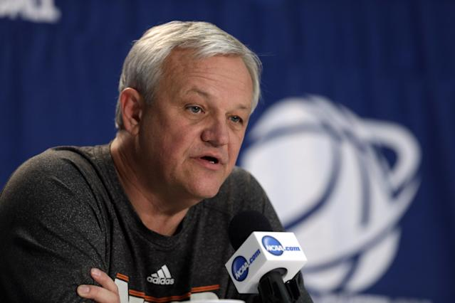 Mercer head coach Bob Hoffman answers a question during a news conference at the NCAA college basketball tournament in Raleigh, N.C., Saturday, March 22, 2014. Mercer plays Tennessee in a third-round game on Sunday. (AP Photo/Chuck Burton)