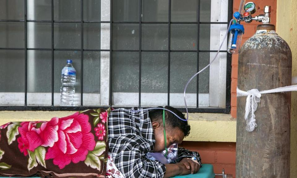 A Covid patient receives oxygen as he lies on a bed outside an emergency ward of a hospital in Kathmandu, Nepal on Friday.