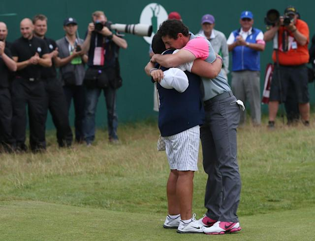 Rory McIlroy of Northern Ireland celebrates winning the British Open Golf championship with his mother Rosie after the final round at the Royal Liverpool golf club, Hoylake, England, Sunday July 20, 2014. (AP Photo/Scott Heppell)