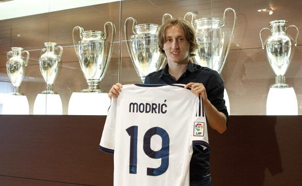 43d521965 Luka Modric poses with his Real Madrid shirt and his Barcelona shirt