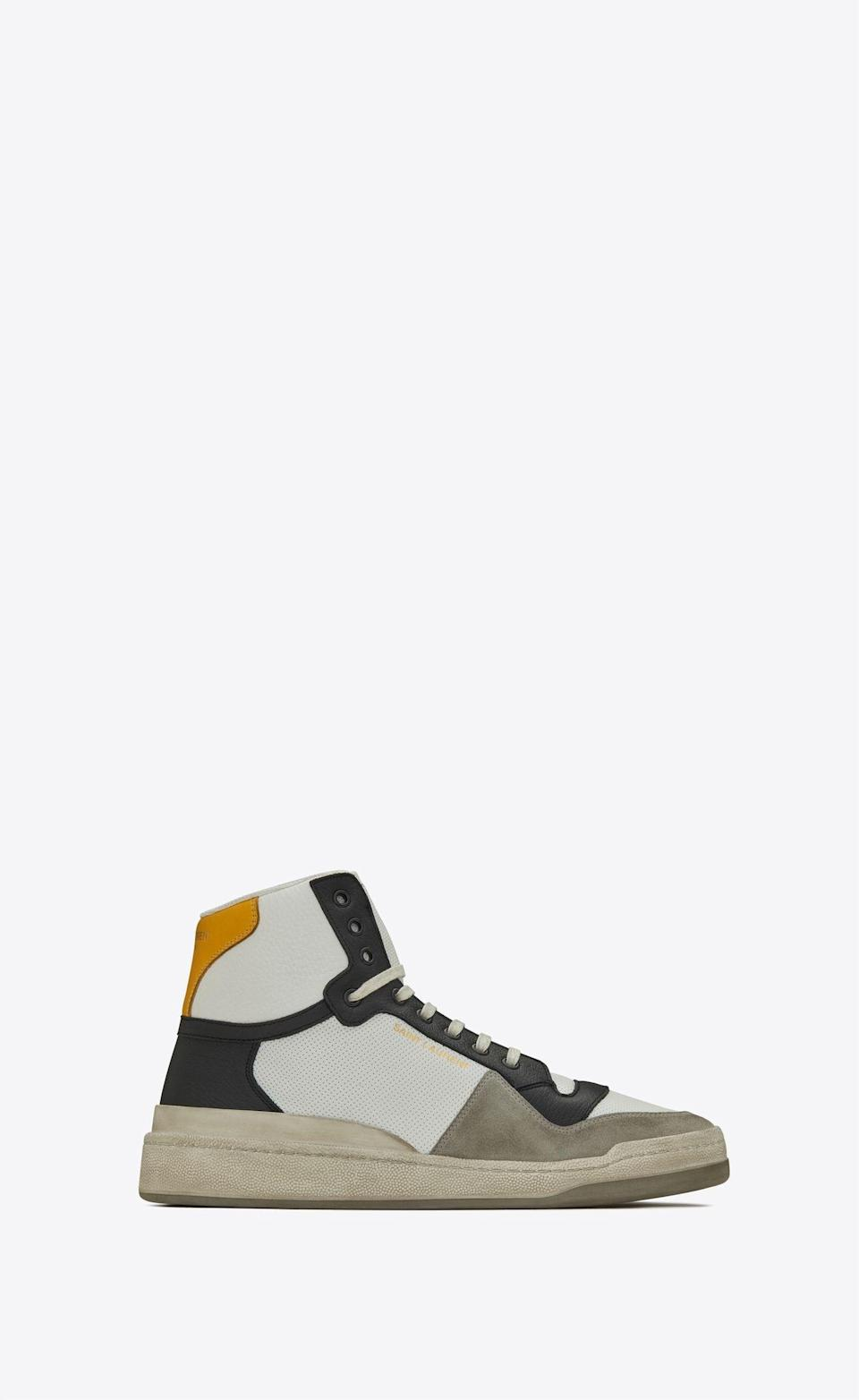 """<p><strong>Saint Laurent</strong></p><p>ysl.com</p><p><strong>$745.00</strong></p><p><a href=""""https://www.ysl.com/us/shop-product/men/shoes-sl24-shoes-sl24-sneakers-in-perforated-leather-and-suede_cod11901170uu.html"""" rel=""""nofollow noopener"""" target=""""_blank"""" data-ylk=""""slk:Shop Now"""" class=""""link rapid-noclick-resp"""">Shop Now</a></p><p>Saint Laurent serving up yet another pair of cool-as-hell, high-end sneakers? Not exactly shocking, but very welcome, nonetheless.</p>"""