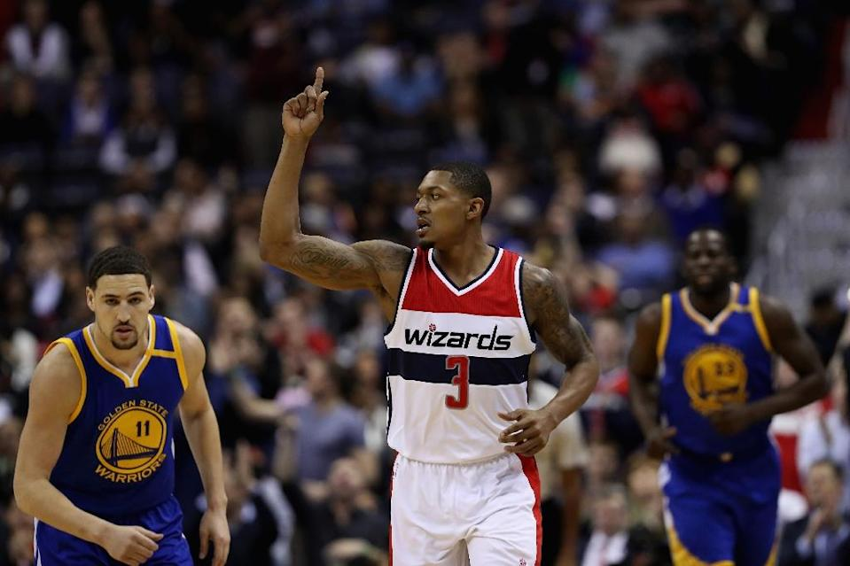 Bradley Beal of the Washington Wizards celebrates after scoring a three pointer against the Golden State Warriors in the first half, at Verizon Center in Washington, DC, on February 28, 2017 (AFP Photo/Rob Carr)