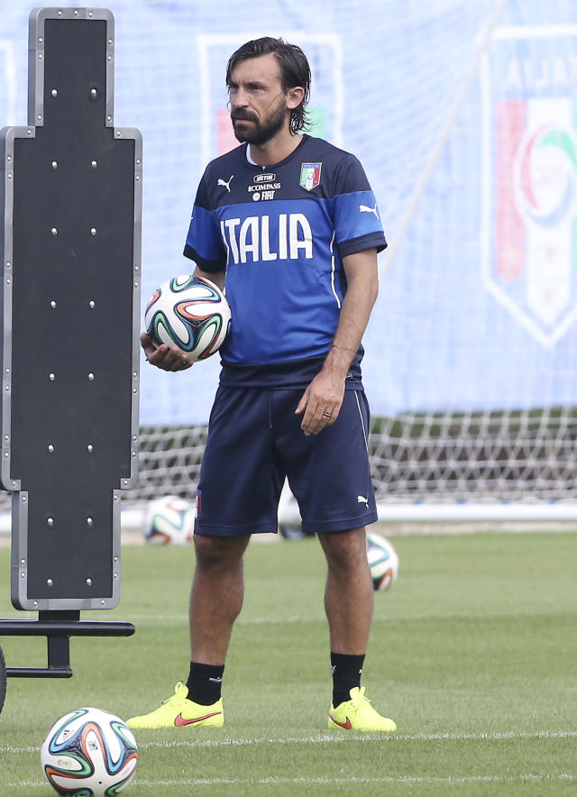 Italy's Andrea Pirlo stands on the pitch at a training session in Mangaratiba, Brazil, Wednesday, June 11, 2014. Italy will play in group D of the Brazil 2014 soccer World Cup. (AP Photo/Antonio Calanni)