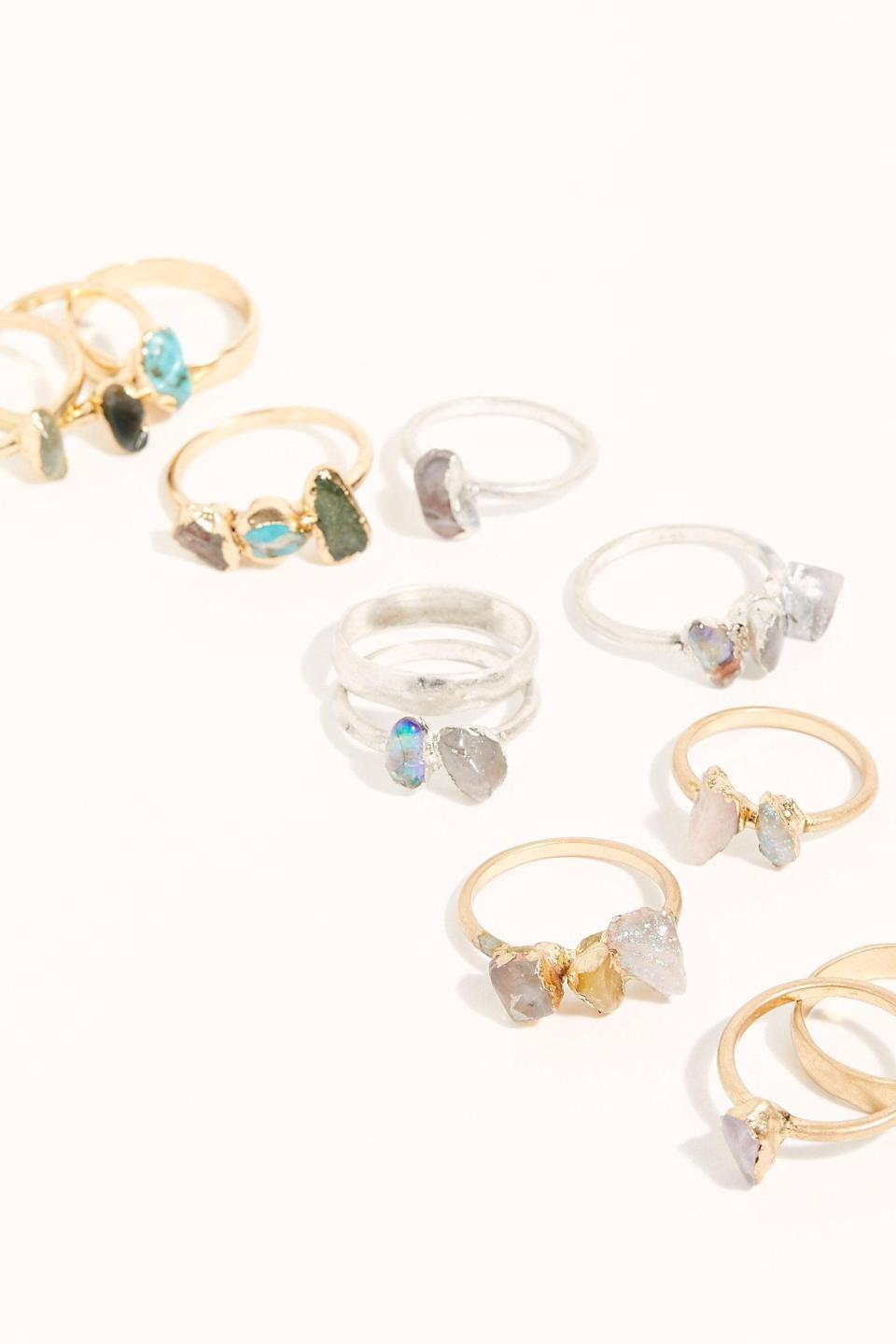 """<p>They'll love rocking all the choices in this <a href=""""https://www.popsugar.com/buy/Raw-Stone-Ring-Set-516225?p_name=Raw%20Stone%20Ring%20Set&retailer=freepeople.com&pid=516225&price=38&evar1=savvy%3Aus&evar9=45472903&evar98=https%3A%2F%2Fwww.popsugar.com%2Fsmart-living%2Fphoto-gallery%2F45472903%2Fimage%2F46937690%2FRaw-Stone-Ring-Set&list1=gifts%2Choliday%2Cstocking%20stuffers%2Cgift%20guide%2Cgifts%20under%20%24100%2Cgifts%20under%20%2450%2Cgifts%20under%20%2475&prop13=mobile&pdata=1"""" class=""""link rapid-noclick-resp"""" rel=""""nofollow noopener"""" target=""""_blank"""" data-ylk=""""slk:Raw Stone Ring Set"""">Raw Stone Ring Set</a> ($38).</p>"""