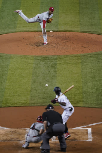 Philadelphia Phillies' Ramon Rosso, top, pitches to Miami Marlins' Jazz Chisholm during the third inning of the first game of a baseball doubleheader, Sunday, Sept. 13, 2020, in Miami. (AP Photo/Wilfredo Lee)