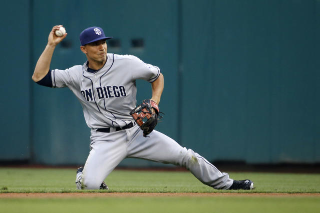 San Diego Padres second baseman Jace Peterson throws to first base after fielding a ground out by Philadelphia Phillies' Jimmy Rollins during the first inning of a baseball game, Tuesday, June 10, 2014, in Philadelphia. (AP Photo/Matt Slocum)