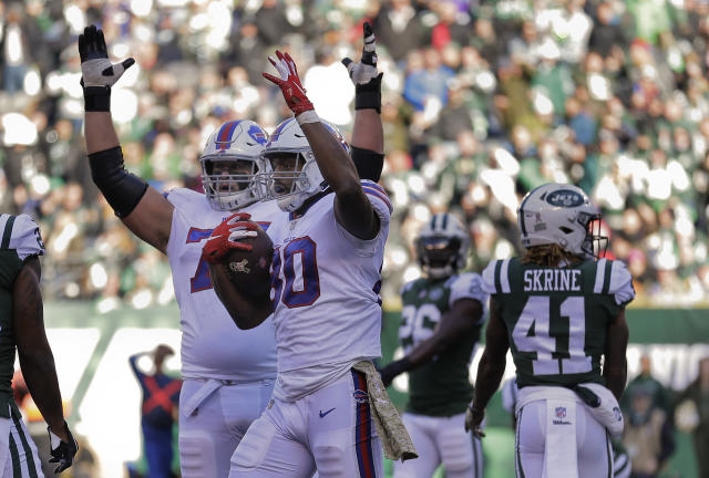 Buffalo Bills tight end Jason Croom (80) and offensive guard Wyatt Teller (75) motion for a touchdown after Croom recovered a fumble in the end zone against the New York Jets during the first quarter of an NFL football game, Sunday, Nov. 11, 2018, in East Rutherford, N.J. (AP)