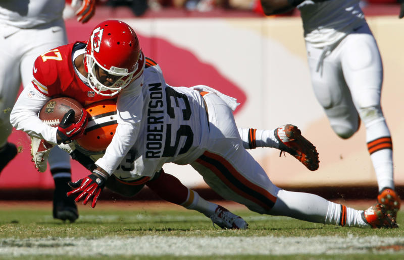 Kansas City Chiefs wide receiver Donnie Avery (17) is tackled by Cleveland Browns inside linebacker Craig Robertson (53) during the second half of an NFL football game in Kansas City, Mo., Sunday, Oct. 27, 2013. (AP Photo/Colin E. Braley)