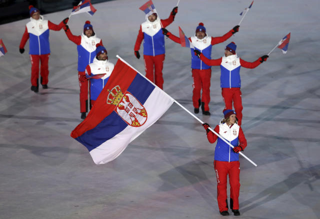 <p>Nevena Ignjatovic carries the flag of Serbia during the opening ceremony of the 2018 Winter Olympics in Pyeongchang, South Korea, Friday, Feb. 9, 2018. (AP Photo/Michael Sohn) </p>