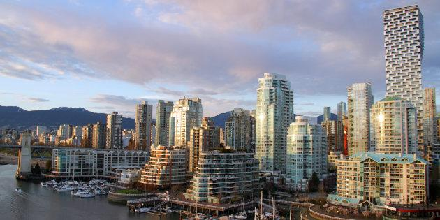 Condo towers along the shore of False Creek in Vancouver. You need to be among the top 25 per cent of earners to afford a benchmark condo in Vancouver or Toronto, according to Zoocasa.