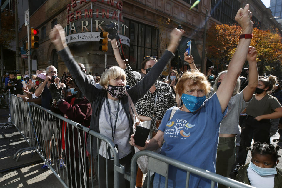 People celebrate outside the Pennsylvania Convention Center, Saturday, Nov. 7, 2020, in Philadelphia, after Democrat Joe Biden defeated President Donald Trump to become 46th president of the United States. (AP Photo/Rebecca Blackwell)