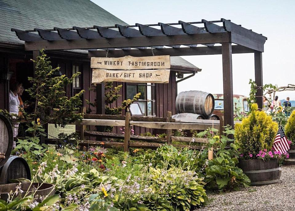 """<p><a href=""""https://benmarl.com/"""" rel=""""nofollow noopener"""" target=""""_blank"""" data-ylk=""""slk:Benmarl Winery"""" class=""""link rapid-noclick-resp"""">Benmarl Winery</a> is a short hour and a half ride north of the city, nestled in the lush green hills of Marlboro beside the Hudson River. It's home to the oldest vineyard in America, and has some of the country's oldest vines of <a href=""""https://www.wine-searcher.com/grape-26-baco-noir"""" rel=""""nofollow noopener"""" target=""""_blank"""" data-ylk=""""slk:Baco Noir"""" class=""""link rapid-noclick-resp"""">Baco Noir</a>—a French-American hybrid grape variety native to the Northeast and Canada. """"For estate wines [wines made from grapes grown on the winery's property], they are unparalleled in the region,"""" Tristen Gild, manager and buyer for Hudson-based <a href=""""https://www.kingstonwine.com/"""" rel=""""nofollow noopener"""" target=""""_blank"""" data-ylk=""""slk:Kingston Wine Co."""" class=""""link rapid-noclick-resp"""">Kingston Wine Co.</a>, says.</p> <p>Like many other growers in New York, Benmarl has a noteworthy Cabernet Franc, and a refreshing Baco Noir rosé with notes of blueberry and strawberry—the perfect Summer wine. (The Margherita pizza from their wood fired oven also hits the spot.)</p> <p>They are open 7 days a week, <a href=""""https://www.exploretock.com/benmarlwinery/"""" rel=""""nofollow noopener"""" target=""""_blank"""" data-ylk=""""slk:reservation-only"""" class=""""link rapid-noclick-resp"""">reservation-only</a>, so remember to book in advance. Stay across the Hudson River at <a href=""""https://roundhousebeacon.com/"""" rel=""""nofollow noopener"""" target=""""_blank"""" data-ylk=""""slk:The Roundhouse"""" class=""""link rapid-noclick-resp"""">The Roundhouse</a> in <a href=""""https://www.cntraveler.com/galleries/2015-01-30/10-things-to-do-in-beacon-new-york?mbid=synd_yahoo_rss"""" rel=""""nofollow noopener"""" target=""""_blank"""" data-ylk=""""slk:Beacon"""" class=""""link rapid-noclick-resp"""">Beacon</a>, and make sure to stop at the newly opened cocktail bar, <a href=""""https://wonderbar.hrpos.heartland.us/menu"""" rel=""""nofollow noopener"""" target="""""""