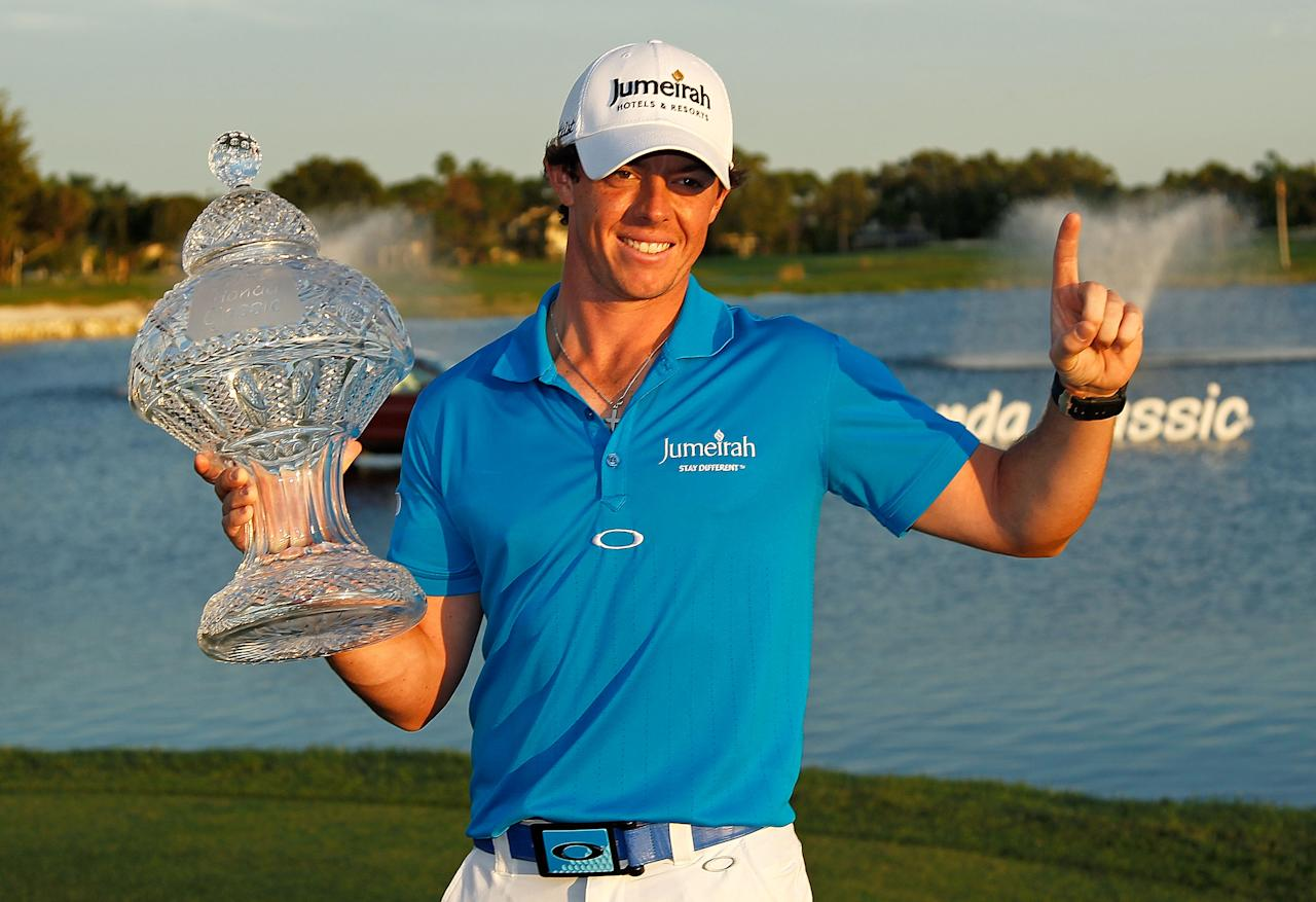 PALM BEACH GARDENS, FL - MARCH 04:  Rory McIlroy of Northern Ireland poses with the trophy after winning the Honda Classic at PGA National on March 4, 2012 in Palm Beach Gardens, Florida.  (Photo by Mike Ehrmann/Getty Images)
