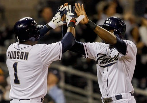 San Diego Padres' Orlando Hudson high fives Cameron Maybin after the paired scored on a double by Mark Kotsay in the eighth inning of a baseball game against the Washington Nationals Thursday, April 26, 2012 in San Diego. The Padres won the game 2-1. (AP Photo/Lenny Ignelzi)