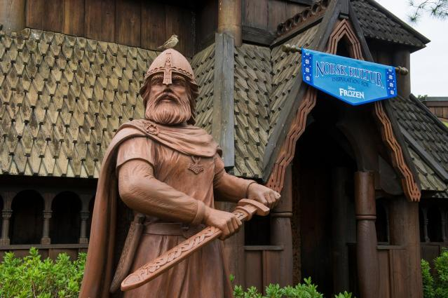 """This Nov. 25, 2013 photo shows the exterior of a new gallery, Norsk Kultur in the Norway pavilion at Epcot at Walt Disney World Resort in Lake Buena Vista, Fla. The new exhibit explores how the culture and beauty of Norway inspired the filmmakers during the creation of Disney's """"Frozen."""" Norsk Kultur, meaning """"Norweigan Culture,"""" features items such as an authentic hand-made bunad, the traditional costume of Norway; a hardanger fiddle and other handmade instruments; hand-carved artisan furniture; examples of rosemaling (traditional Norse decorative painting). (AP Photo/Disney, Gene Duncan)"""
