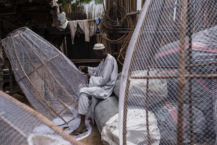 Before conflict swept across northeast Nigeria, fishing was one of the region's largest sources of income. But few fishermen now dare venture out onto Lake Chad (AFP Photo/STEFAN HEUNIS)