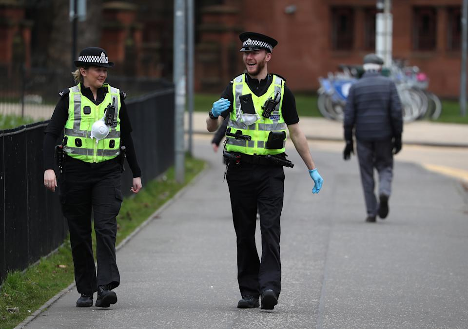 Police patrol the streets near Kelvingrove Art Gallery and Museum as the UK continues in lockdown to help curb the spread of the coronavirus.