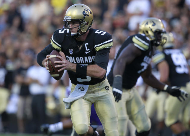 Colorado quarterback Connor Wood runs around the end for a five-yard gain and a first down against Central Arkansas in the first quarter of a college football game in Boulder, Colo., on Saturday, Sept. 7, 2013. (AP Photo/David Zalubowski)