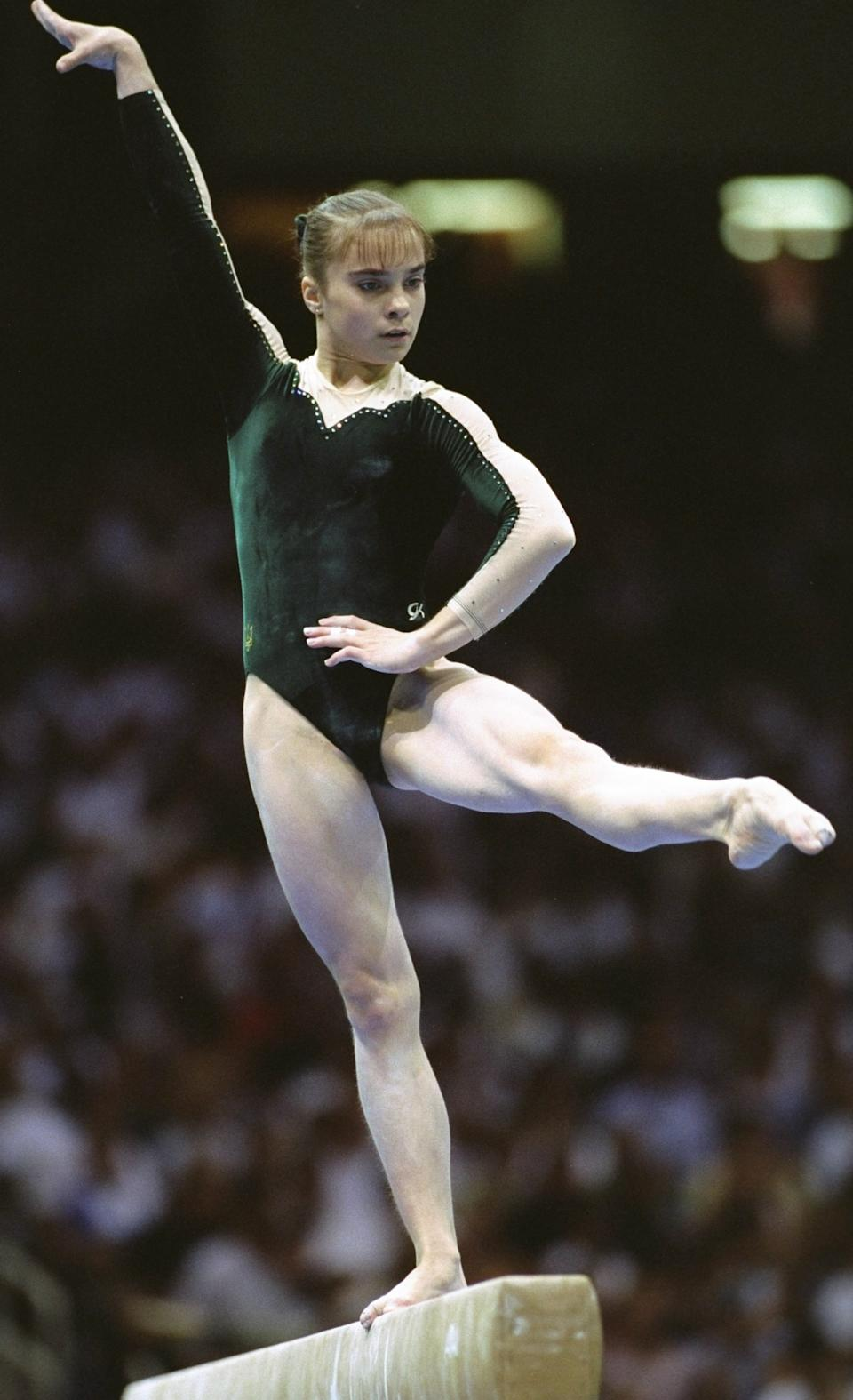 25 Jul 1996: Lilia Podkopayeva of the Ukraine wins gold for the womens individual all around gymnastics at the Georgia Dome at the 1996 Centennial Olympic Games in Atlanta Georgia.
