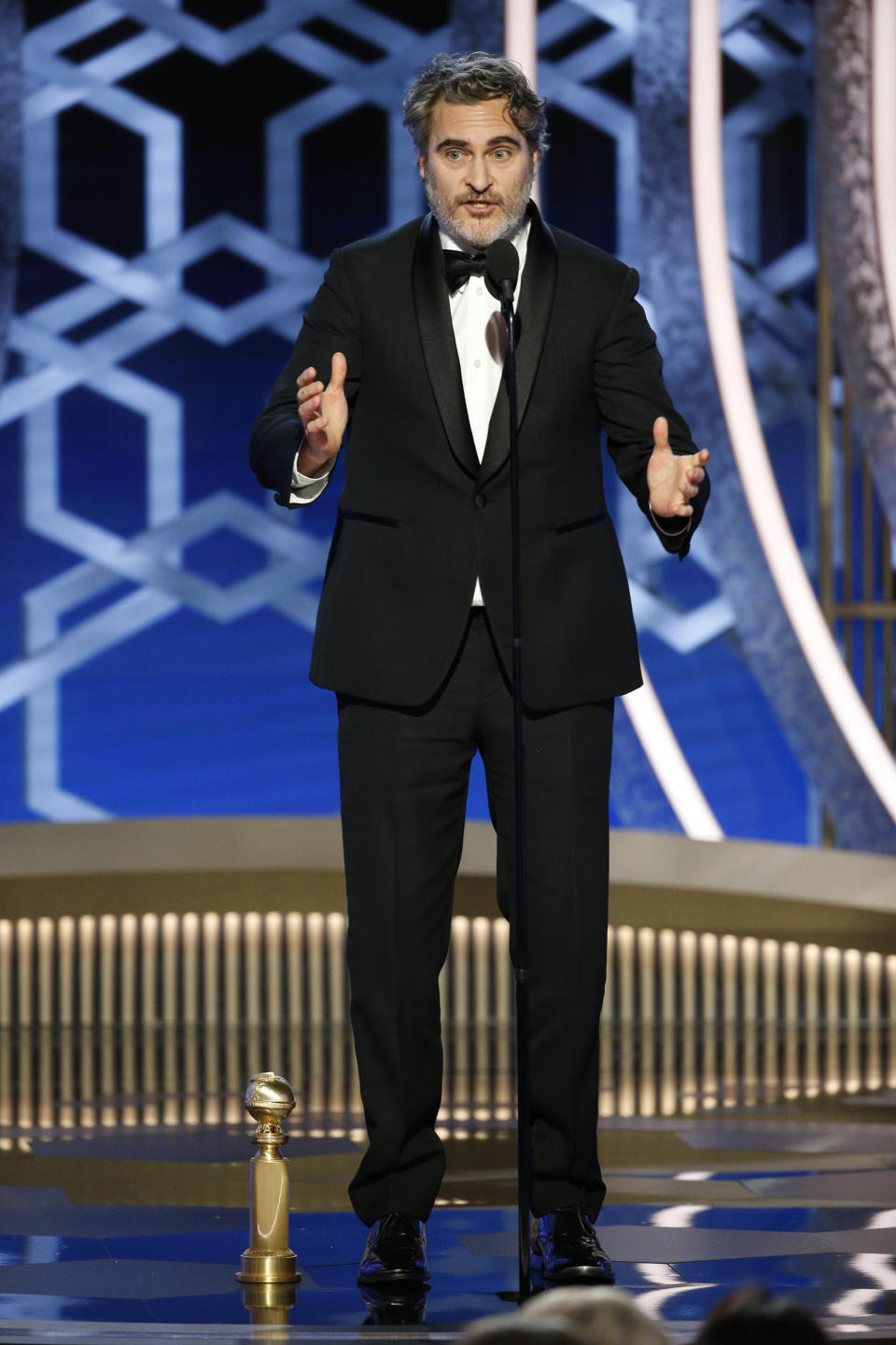 "BEVERLY HILLS, CALIFORNIA - JANUARY 05: In this handout photo provided by NBCUniversal Media, LLC,  Joaquin Phoenix accepts the award for BEST PERFORMANCE BY AN ACTOR IN A MOTION PICTURE - DRAMA for ""Joker"" onstage during the 77th Annual Golden Globe Awards at The Beverly Hilton Hotel on January 5, 2020 in Beverly Hills, California. (Photo by Paul Drinkwater/NBCUniversal Media, LLC via Getty Images)"