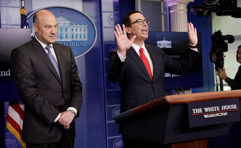 U.S. National Economic Director Cohn and Treasury Secretary Mnuchin end their breifing after unveiling Trump administration's tax reform proposal at White House in Washington