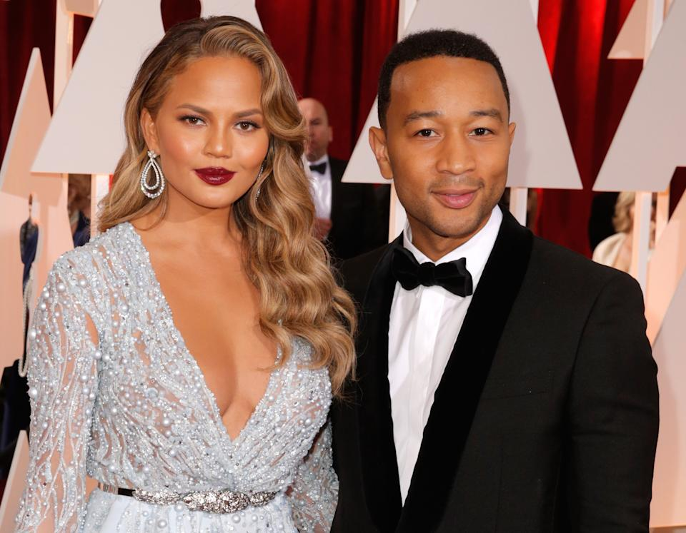 Chrissy Teigen, left, and John Legend arrives at the Oscars on Sunday, Feb. 22, 2015, at the Dolby Theatre in Los Angeles. (Photo by Todd Williamson/Invision/AP)