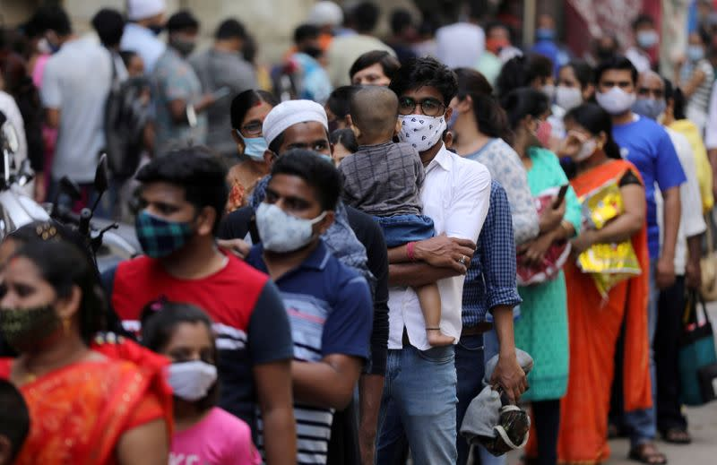 FILE PHOTO: People wait in a line to enter a supermarket amidst the spread of the coronavirus disease (COVID-19) in Mumbai