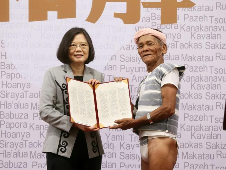 Taiwanese President Tsai Ing-wen poses with 80-year-old Yami leader Capen Nganaen as she welcomes indigenous community members to her office in Taipei on August 1, 2016