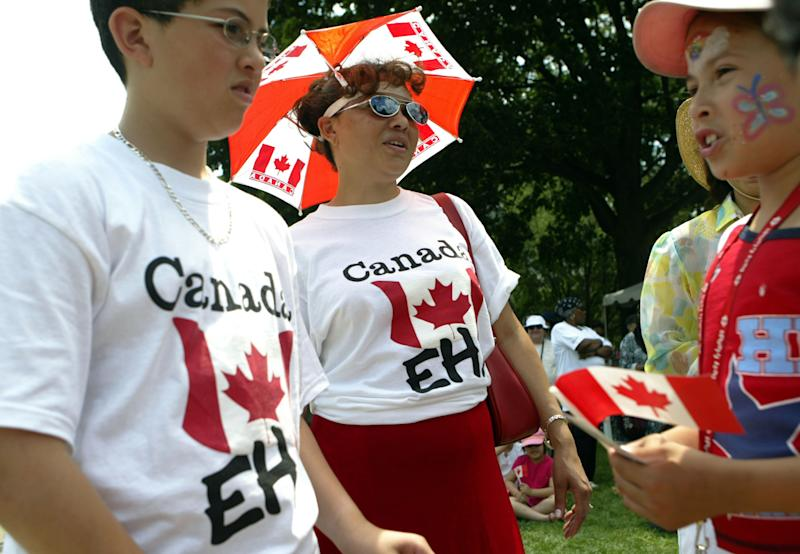 TORONTO - JULY 1: People celebrate Canada's 138th birthday at Queen's Park on July 1, 2005 in Toronto, Canada. July 1st, known as Canada Day, celebrates the day the Canadian government was created. (Photo by Donald Weber/Getty Images)