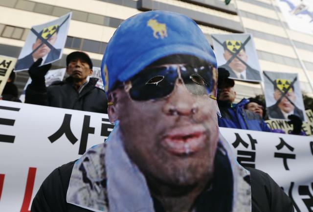 A protester attends a rally denouncing Rodman's visit to North Korea and North Korean leader Kim Jong Un on Kim's birthday in central Seoul