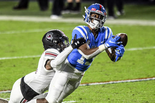 Mississippi wide receiver Braylon Sanders (13) makes a catch against South Carolina defensive back Cam Smith, left, in the second half of an NCAA college football game in Oxford, Miss., Saturday, Nov. 14, 2020. (AP Photo/Bruce Newman)