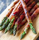 <p>Make asparagus a bit more substantial by wrapping in parma ham, and serve up with boiled or poached eggs to make a delicate, but filling dinner made in minutes. <i>[Picture: Instagram/Irena Macri]</i></p>