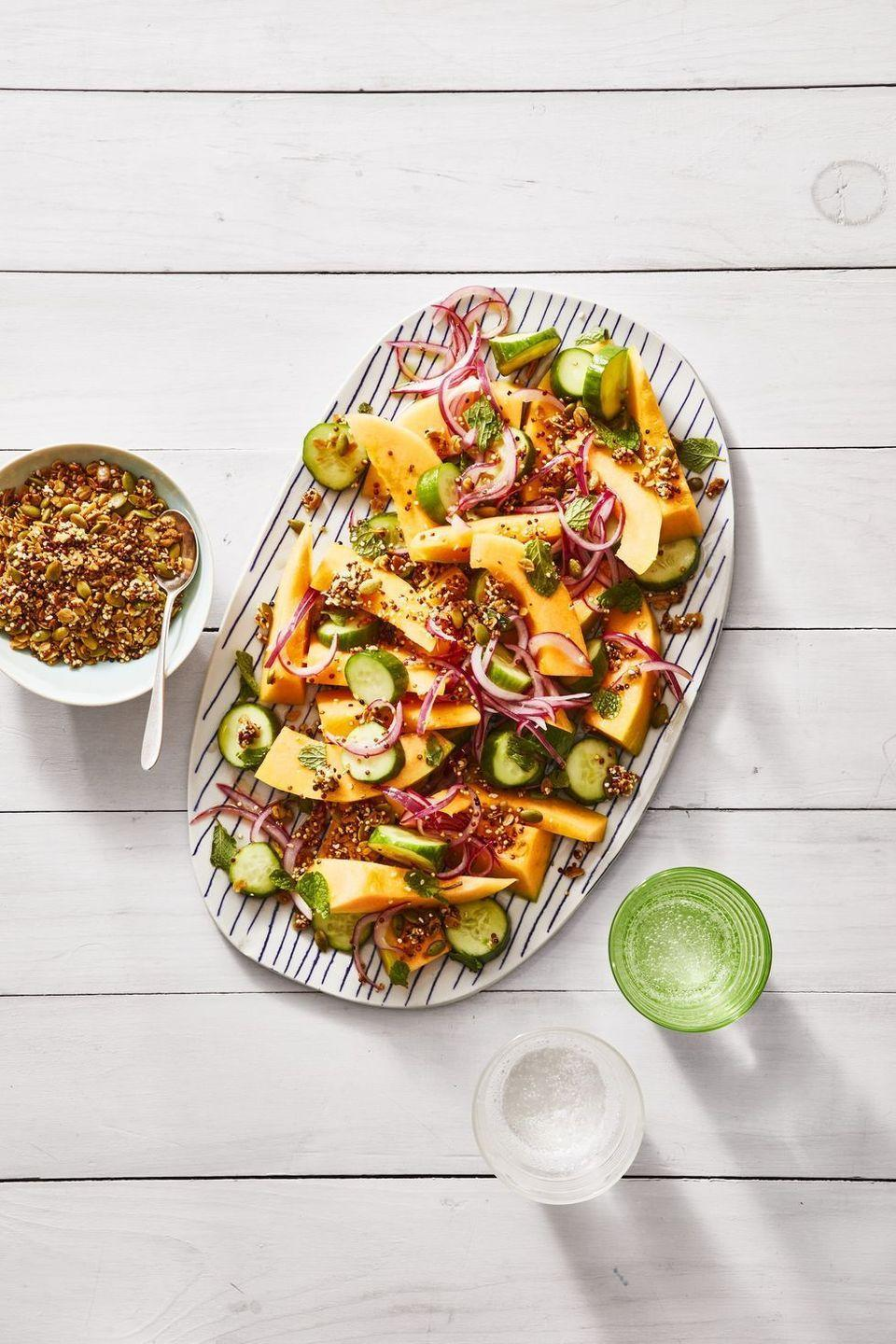 """<p>Skip basic fruit salad. This cool and crunchy side is packed with fresh flavor.</p><p><em><a href=""""https://www.goodhousekeeping.com/food-recipes/a27530675/cucumber-and-cantaloupe-salad-with-savory-quinoa-granola-recipe/"""" rel=""""nofollow noopener"""" target=""""_blank"""" data-ylk=""""slk:Get the recipe for Cucumber and Cantaloupe Salad with Savory Quinoa Granola »"""" class=""""link rapid-noclick-resp"""">Get the recipe for Cucumber and Cantaloupe Salad with Savory Quinoa Granola »</a></em></p>"""
