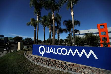 FILE PHOTO: A sign on the Qualcomm campus is seen in San Diego, California, U.S. November 6, 2017. REUTERS/Mike Blake/File Photo