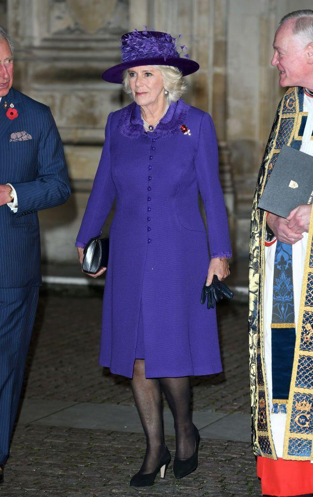 <p>Camilla attends the Centenary of the Armistice Service at Westminster Abbey. The Duchess of Cornwall paired her matching purple coat and hat with a black clutch for the service. </p>