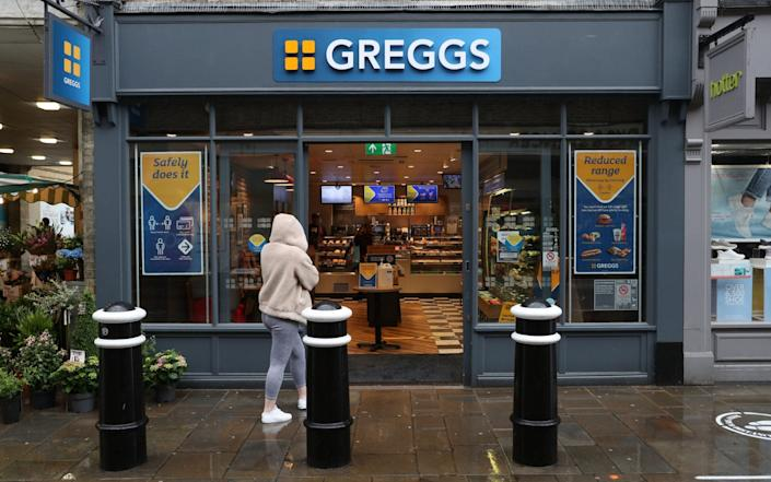 A customer enters a Greggs in Winchester as the bakery reopens 800 stores across the UK today - PA