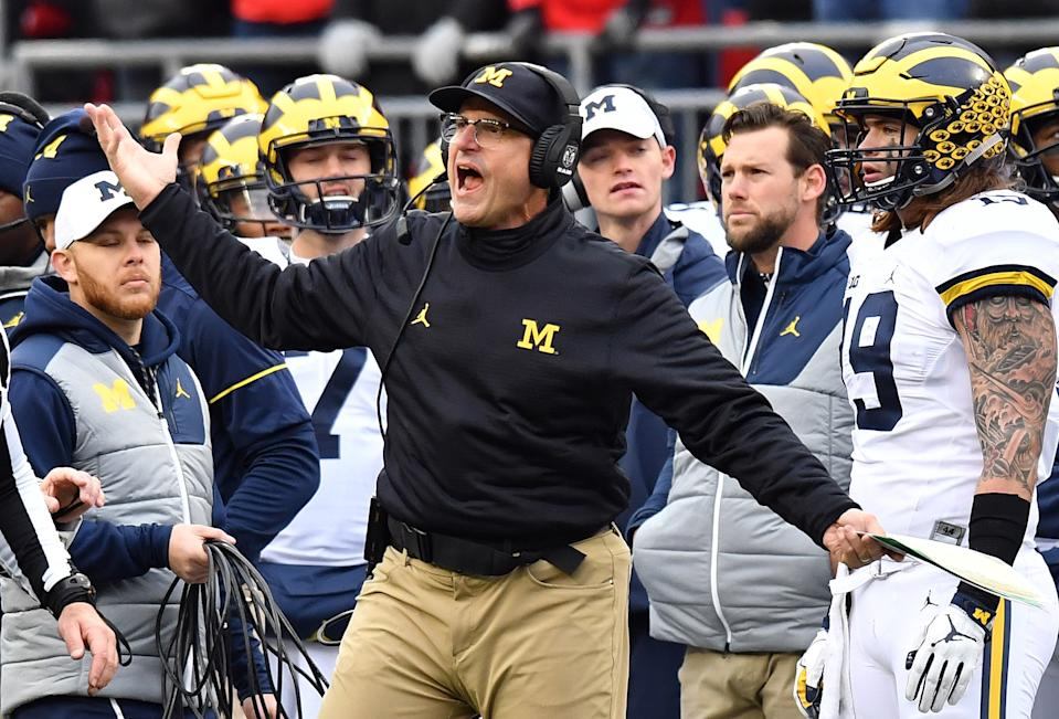 COLUMBUS, OH - NOVEMBER 26:   Head coach Jim Harbaugh of the Michigan Wolverines argues a call on the sideline during the second half against the Ohio State Buckeyes at Ohio Stadium on November 26, 2016 in Columbus, Ohio.  (Photo by Jamie Sabau/Getty Images)