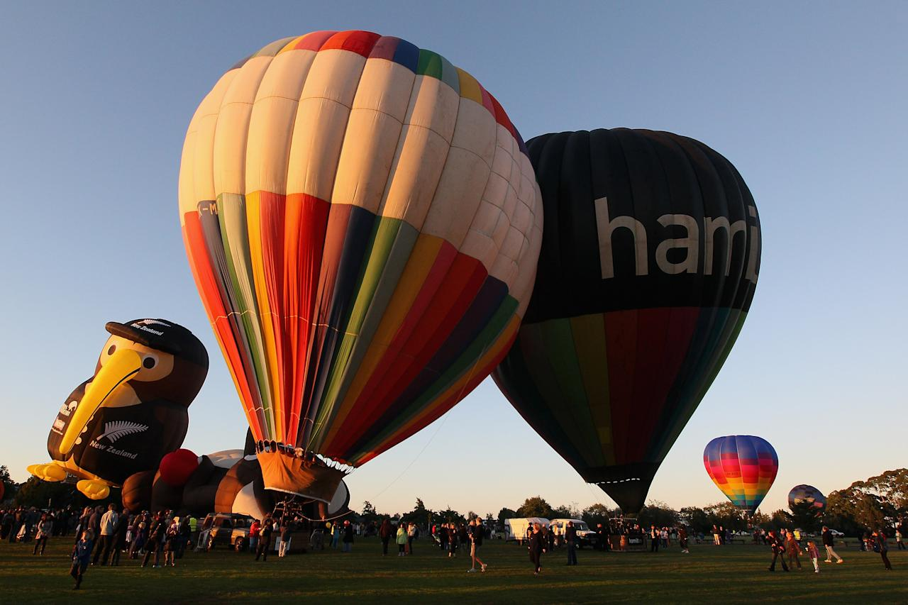 Hot air balloons are inflated over Innes Common Park on March 29, 2012 in Hamilton, New Zealand. Each Autumn over 30 hot air balloons grace the sky as part of the Balloons Over Waikato Festival.  (Photo by Sandra Mu/Getty Images)