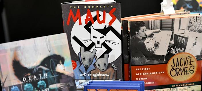 "<span class=""caption"">The success of 'Maus' made the genre more visible.</span> <span class=""attribution""><a class=""link rapid-noclick-resp"" href=""https://www.gettyimages.com/detail/news-photo/view-of-graphic-novels-for-sale-during-new-york-comic-con-news-photo/1045587282"" rel=""nofollow noopener"" target=""_blank"" data-ylk=""slk:Photo by Noam Galai/Getty Images for New York Comic Con"">Photo by Noam Galai/Getty Images for New York Comic Con</a></span>"