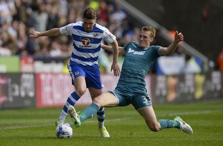 Britain Football Soccer - Reading v Wigan Athletic - Sky Bet Championship - The Madejski Stadium - 29/4/17 Reading's George Evans in action with Wigan Athletic's Dan Burn Mandatory Credit: Action Images / Adam Holt Livepic