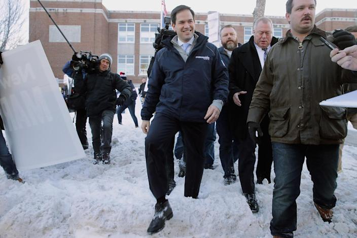 <p>Republican presidential candidate Sen. Marco Rubio walks through snow after stopping to thank supporters outside the polling place at Webster School in Manchester, N.H., on Feb. 9, 2016. <i>(Photo: Chip Somodevilla/Getty Images)</i></p>