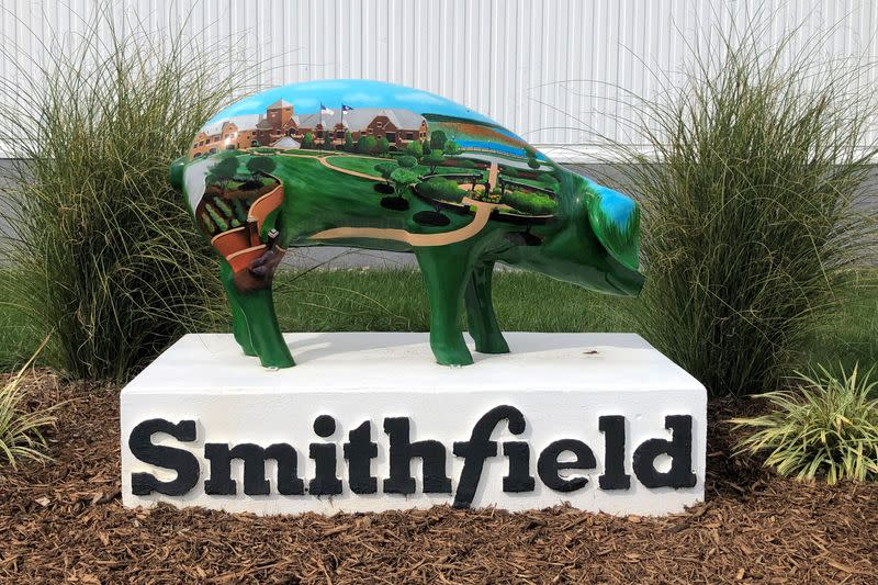 FILE PHOTO: A sculpture adorns Smithfield Foods' hog slaughterhouse in Smithfield