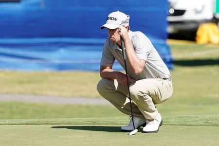 Jan 10, 2019; Honolulu, HI, USA; PGA golfer Andrew Putnam lines up a putt on the 18th hole during the first round of the Sony Open in Hawaii golf tournament at Waialae Country Club. Mandatory Credit: Brian Spurlock-USA TODAY Sports