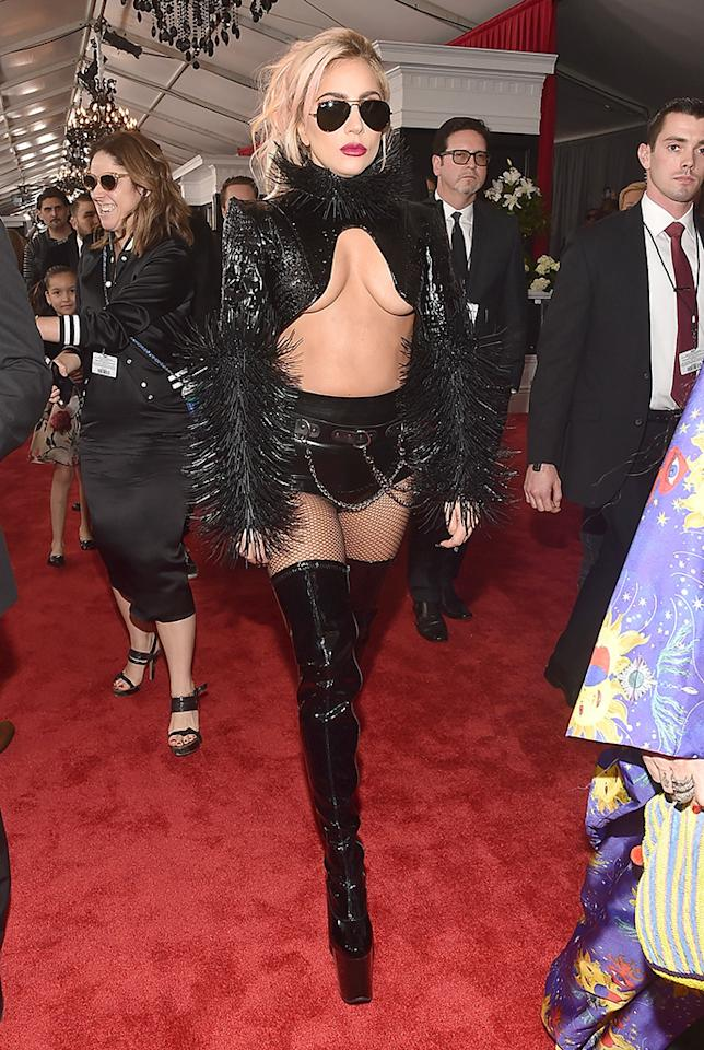 <p>There's nothing like a thigh-high pair of boots, hot pants, and a revealing bolero jacket to get a girl feeling good about herself — just ask Lady Gaga. The pop star — who went through a tough breakup in 2016 but is rumored to now be dating her agent, Christian Carino — hit the Grammys in a black, barely there ensemble that flashed plenty of skin, most notably, her breasts. (Like Halsey, she skipped the shirt and bra.) At least she had her sunglasses on. (Photo: Alberto E. Rodriguez/Getty Images for NARAS) </p>