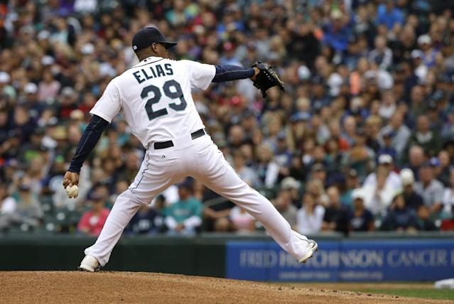 Seattle Mariners starting pitcher Roenis Elias throws against the Washington Nationals in the first inning of a baseball game, Saturday, Aug. 30, 2014, in Seattle. (AP Photo/Ted S. Warren)