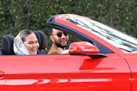<p>John Legend and Chrissy Teigen were spotted riding around Beverly Hills with their dog in a red convertible. </p>
