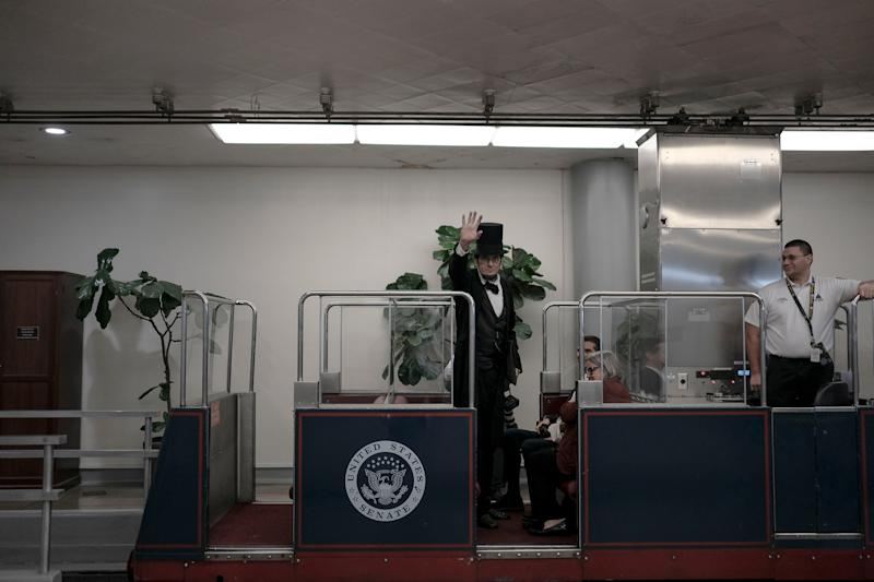George Buss, a Lincoln impersonator, rides the Senate subway before the impeachment vote at the Capitol in Washington, D.C., on Feb. 5, 2020. | Gabriella Demczuk for TIME