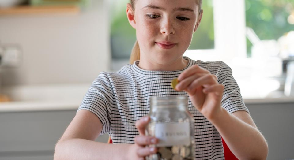 A TikTok user is making her daughter pay 'bills' from the pocket money she's earned (posed by model, Getty)