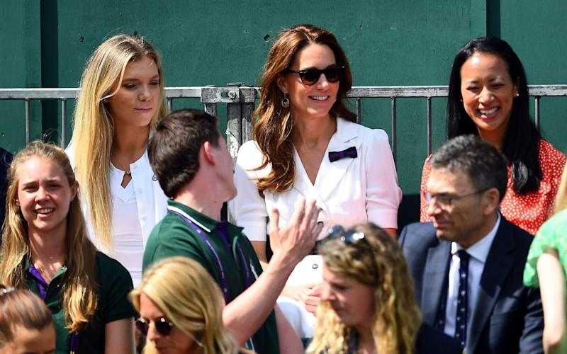 The Duchess of Cambridge with Katie Boulter (left) and Anne Keothavong (right) court side on day two of the Wimbledon Championships - PA